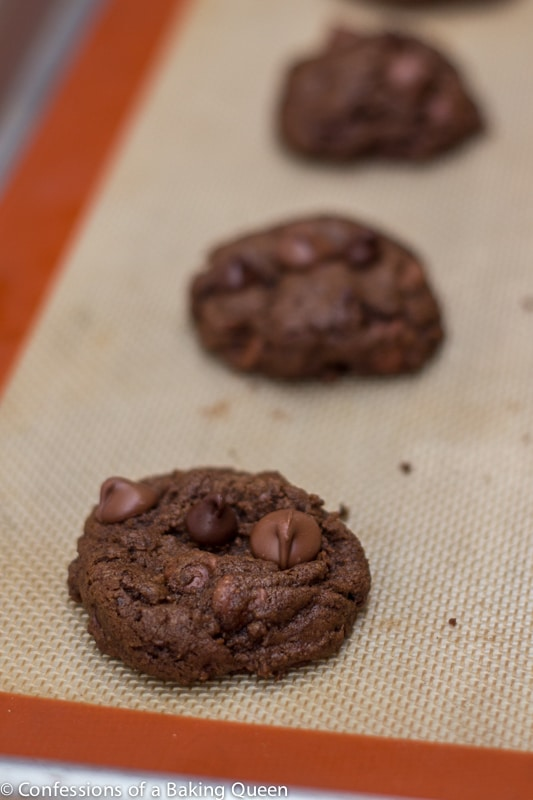 close up of Triple Chocolate Thin Mint Cookies on a baking sheet lined with a silpat liner