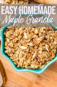 homemade maple granola in a turquoise bowl on a wood background