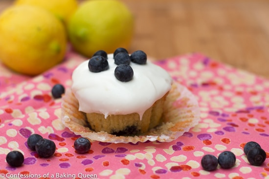 Lemon Blueberry Cupcakes on a pink napkin on a wood board