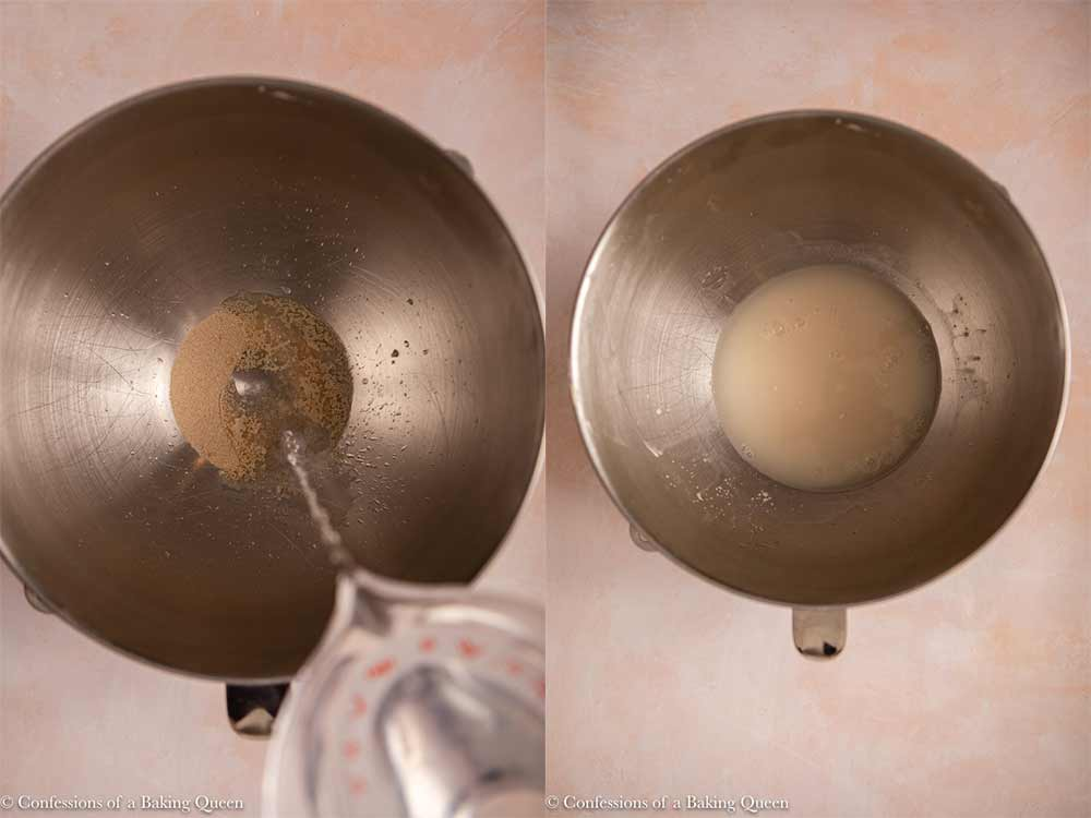 warm water activating yeast in a metal bowl on a light pink surface