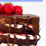 strawberries and cream chocolate cake served on a white plate
