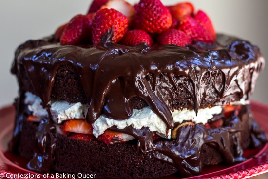 Strawberries and Cream Chocolate Cake on a red cake stand