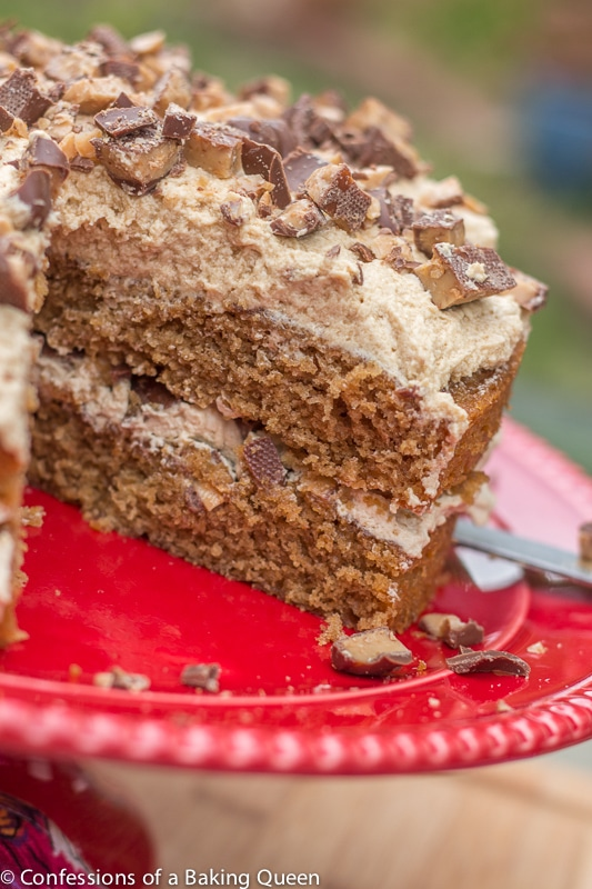 Close up of Coffee Heath Bar Crunch Cake on red cake stand