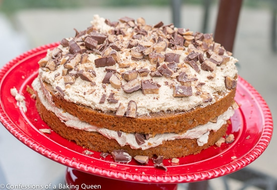 Coffee Heath Bar Crunch Cake on a red cake plate on a glass table top