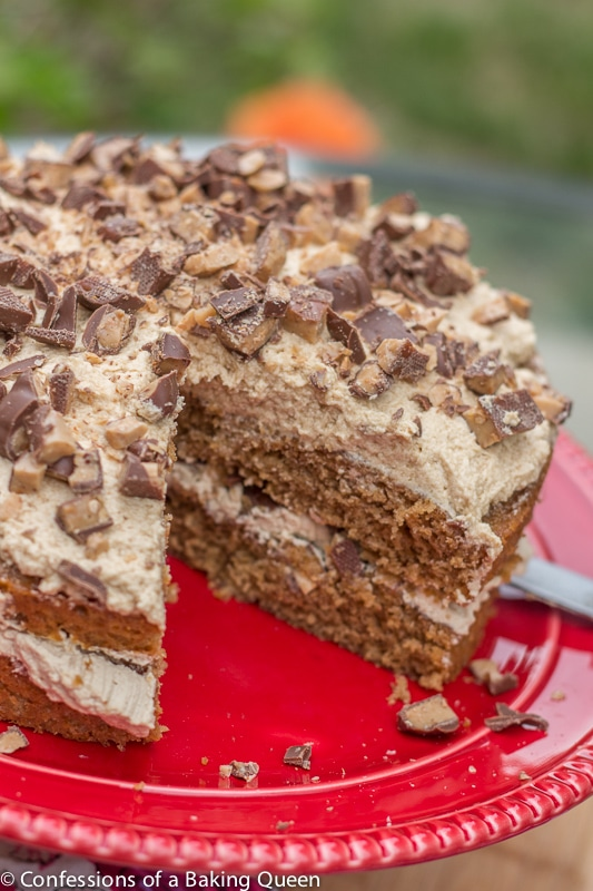 Coffee Heath Bar Crunch Cake showing the inside of the cake on a red plate