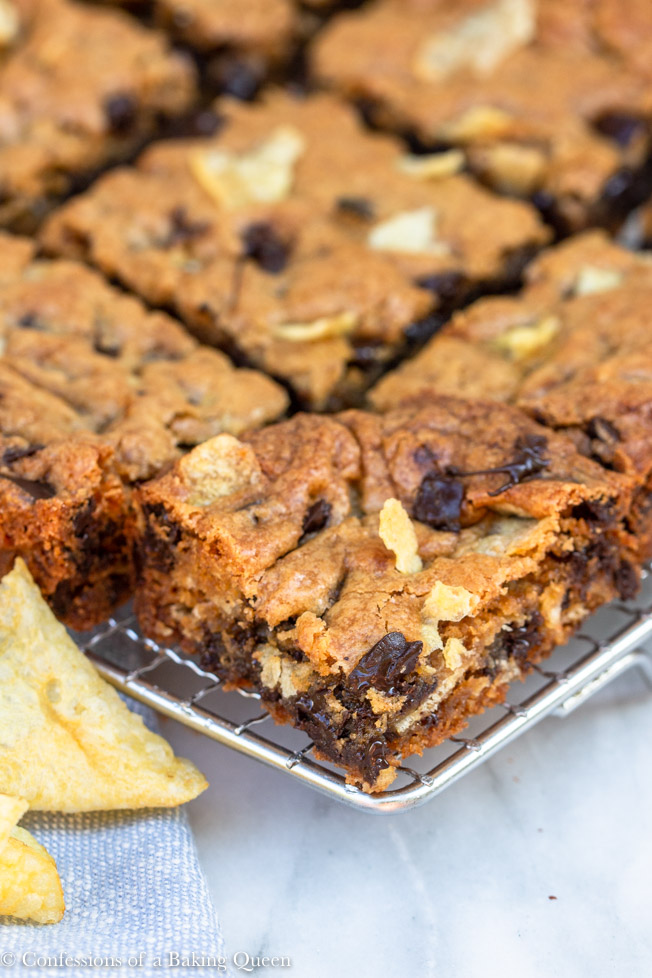 potato chip chocolate chunk blondies up close on a wire rack