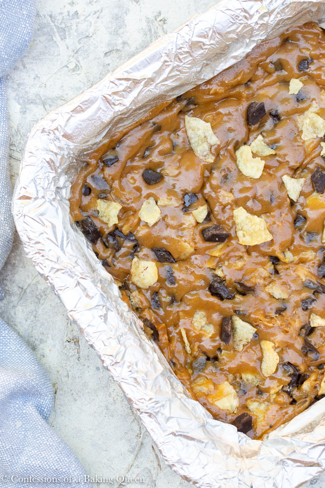 potato chip chocolate chunk blondie batter in a foil lined pan before baking