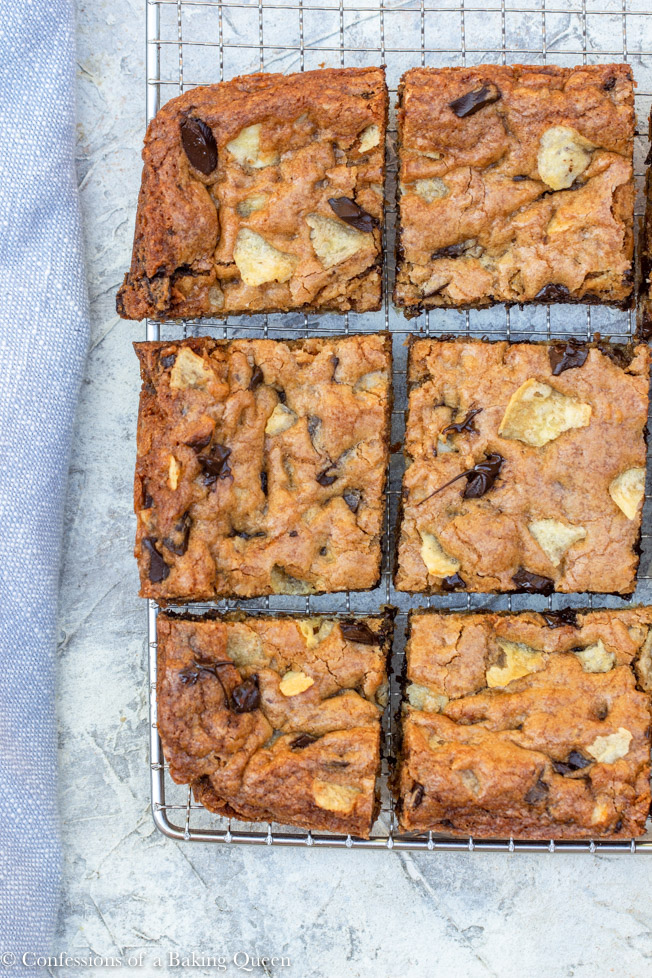 chocolate chunk potato chip blondies cut into squares cooling on a wire rack