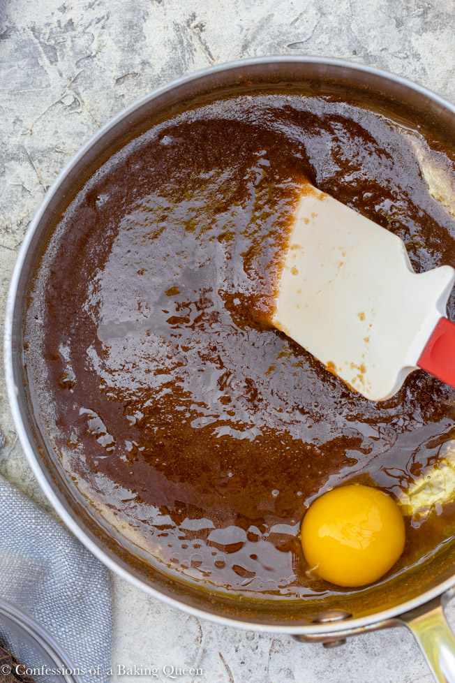 egg added to wet ingredients in a large pot for a chocolate chunk potato chip blondie recipe