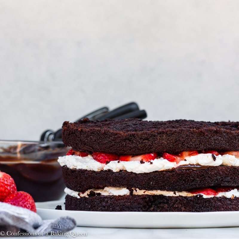 layers of chocolate strawberries and cream cake