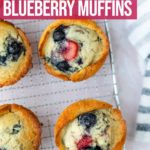 strawberry blueberry muffins cooling on a wire rack