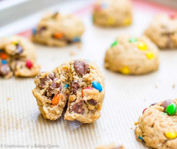 Brown Butter Oat & M&M Cookies baked and broken in half on cookie sheet