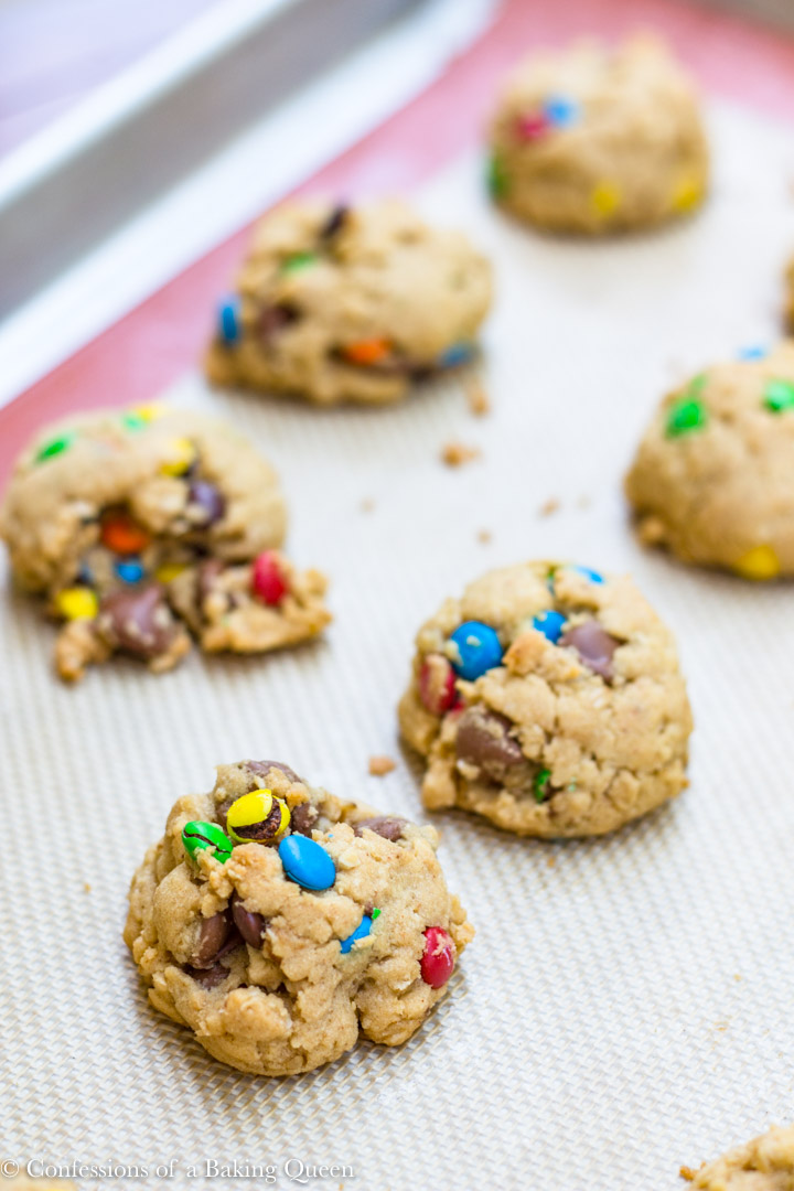 Brown Butter Oat & M&M Cookies baked on a silpat lined cookie sheet