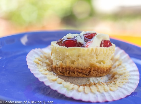 White Chocolate Cherry Cheesecake Cups unwrapped on a blue plate