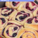 berry sweet rolls baked to golden brown in a metal pan