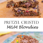 Pretzel Crusted M&M Blondies stacked on top of each other broken in half on a wood board