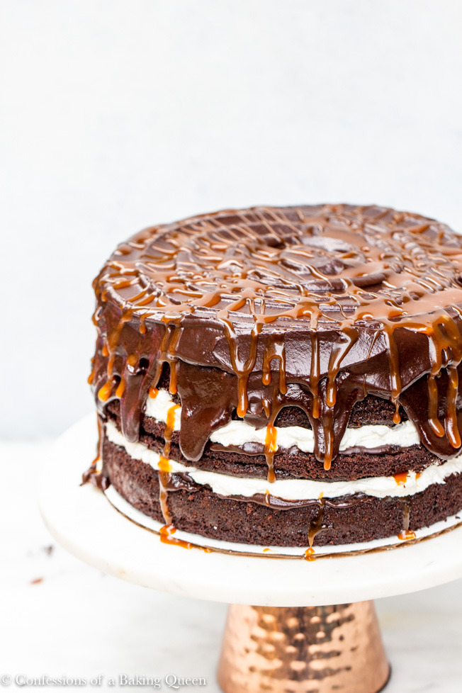 Salted Caramel Chocolate Cake showing top of cake caramel swirls on a white background