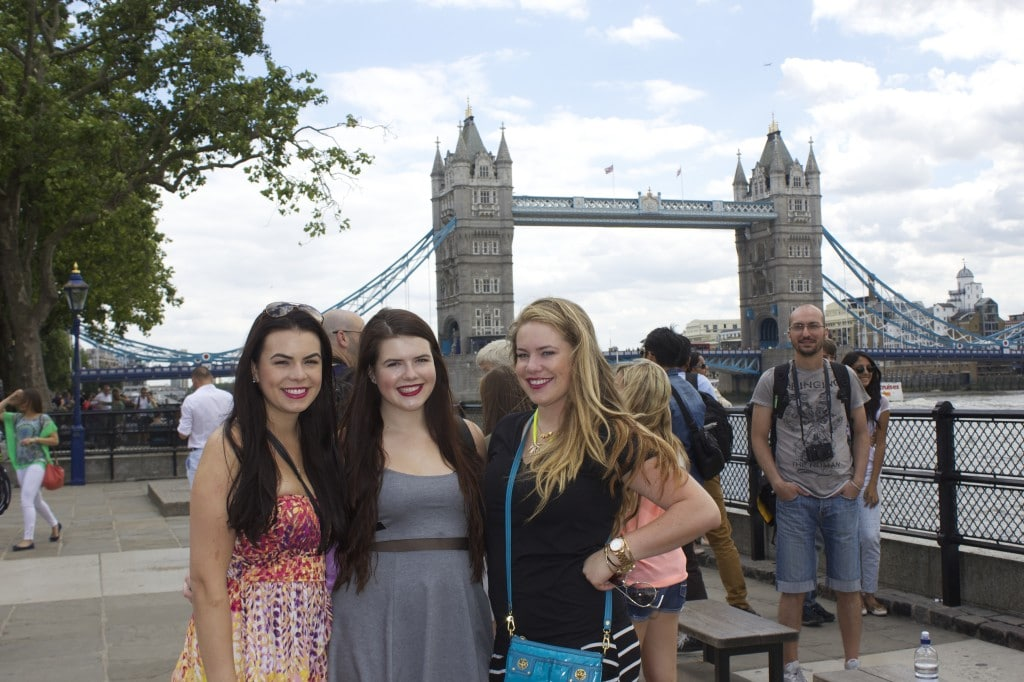 three sisters outside the tower bridge in london