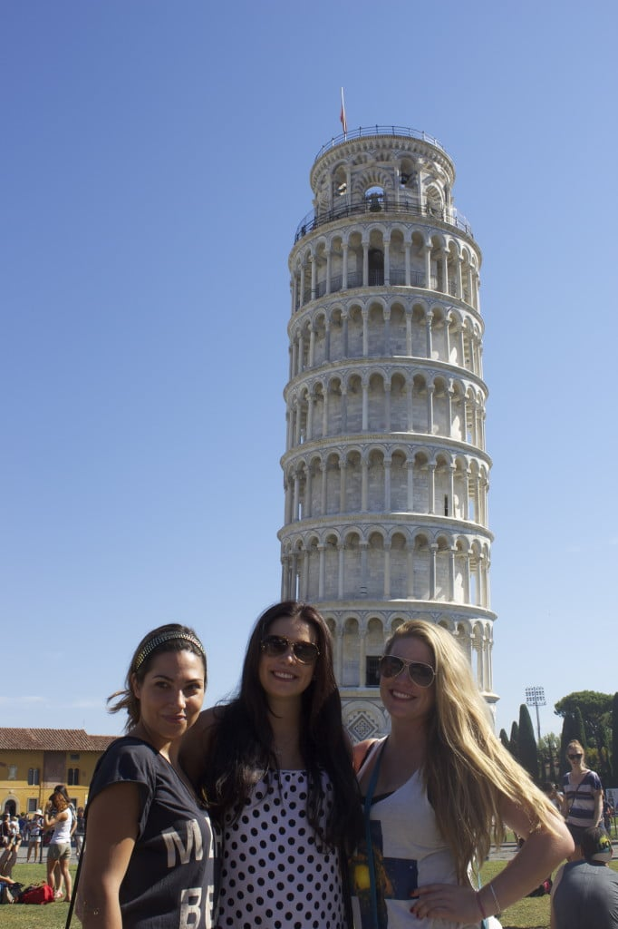 three girls in front of the leaning tower of pisa