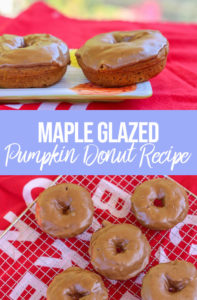 Maple Glazed Pumpkin Donuts on a wire rack on a red towel