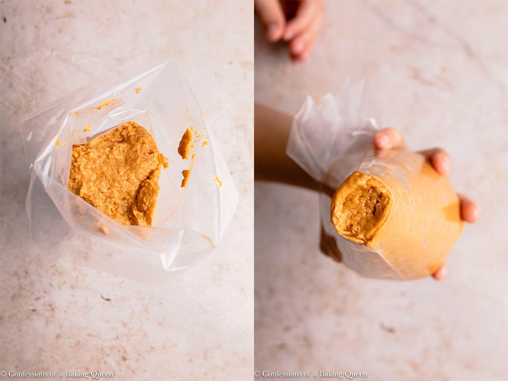 pumpkin donut batter in a clear piping bag