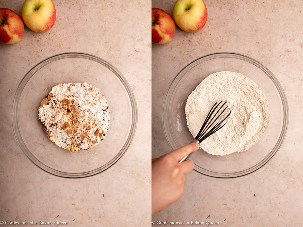 dry ingredients whisked together in a glass bowl on a light brown surface with two apples