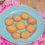 Homemade Cheese Crackers on a blue plate with a pink naplkin