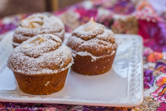 Maple Cream Filled Pumpkin Muffins on a white plate on a pink and purple floral linen