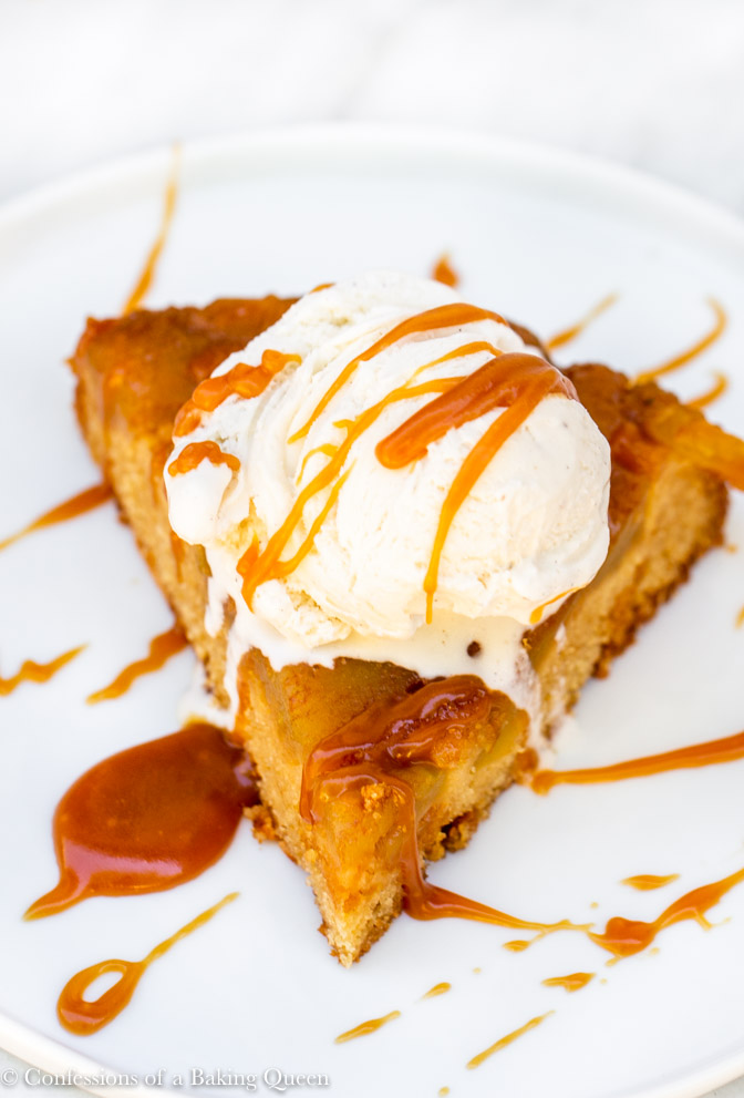 upside down caramel apple cake served with a scoop of vanilla ice cream and drizzles of salted caramel