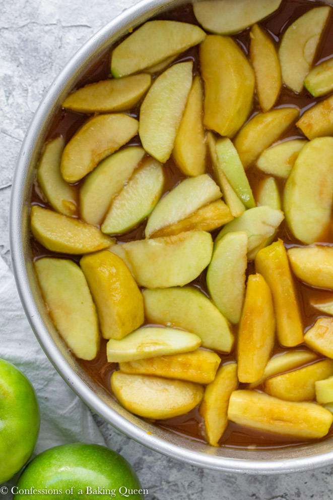 bottom layer of apples and caramel in an upside down caramel apple cake recipe