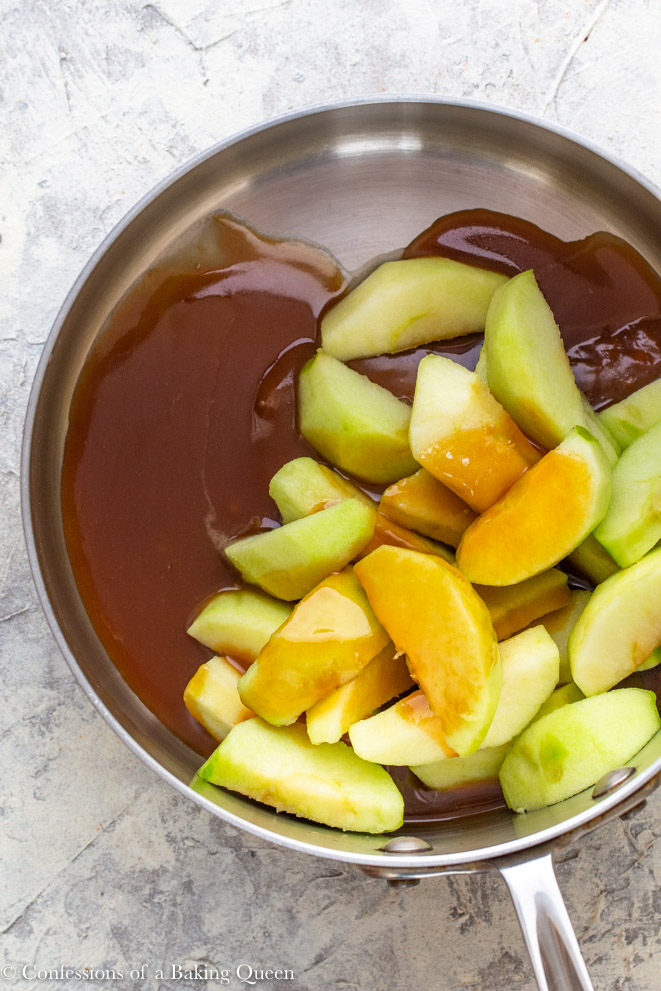 thick apple slices and caramel sauce in a heavy bottomed pot before cooking