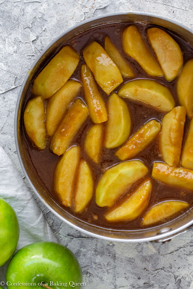 cooked apples in caramel in a large metal pot