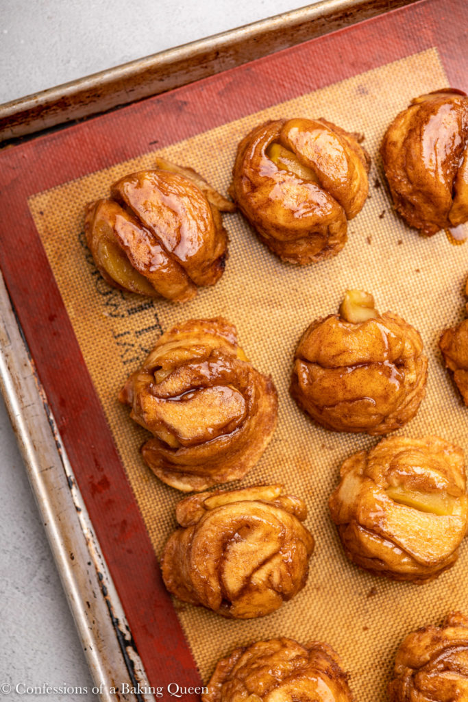 apple monkey bread muffins on a silpat lined sheet pan