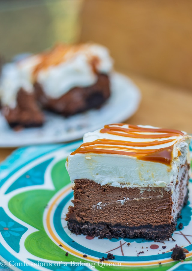 salted caramel chocolate cheesecake bars on a blue and green plate