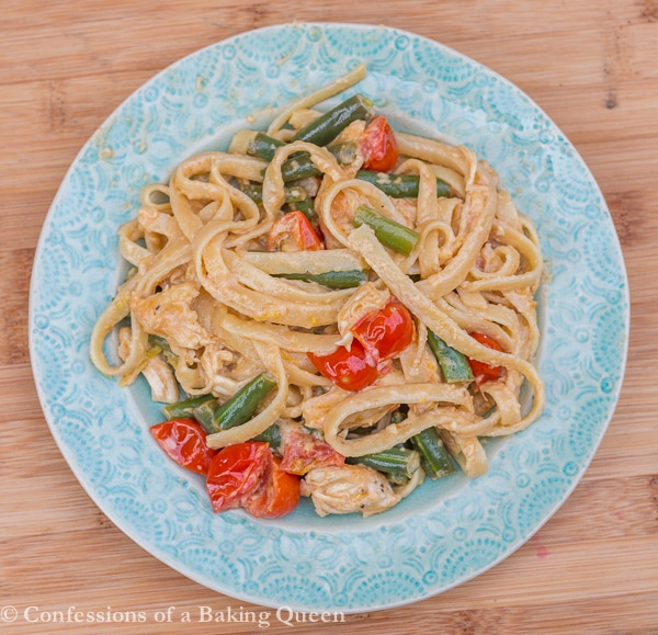 Lemon Garlic Cream Pasta served on a blue plate on a wood board