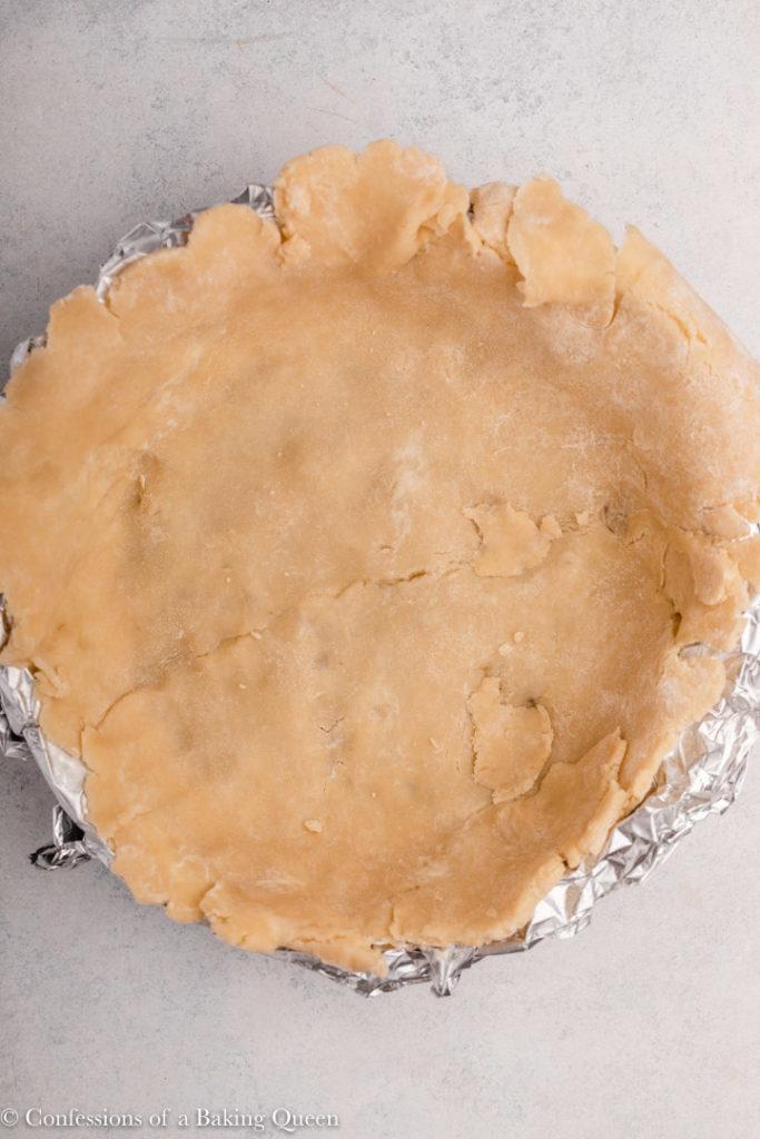 pie dough in a foil lined pie dish