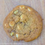 Salted Caramel Apple White Chocolate Cookie close up on a wood board