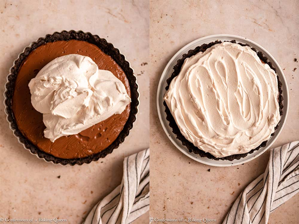 whipped cream added to chocolate tart on a light brown surface next to a white and blue linen
