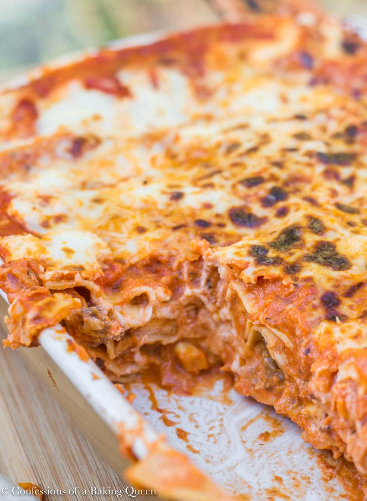 rosa lasagna in a white casserole dish