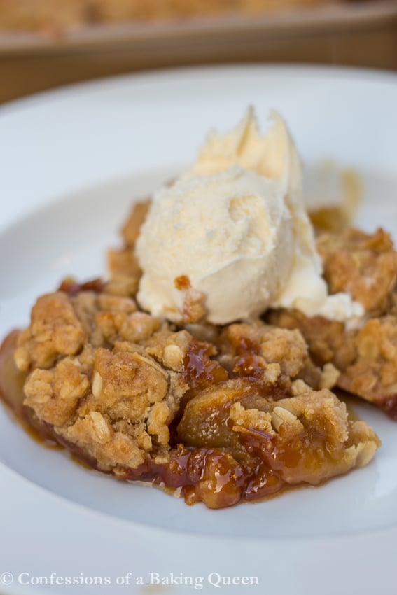 Caramel Apple Crisp served in a white dish with a scoop of ice cream on top