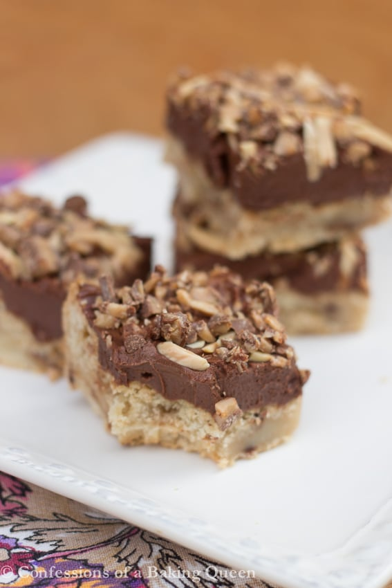 Mascarpone Chocolate Toffee Bar missing a bite with more bars in the background