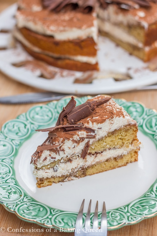 Tiramisu Layer Cake Slice on a white plate with green rim