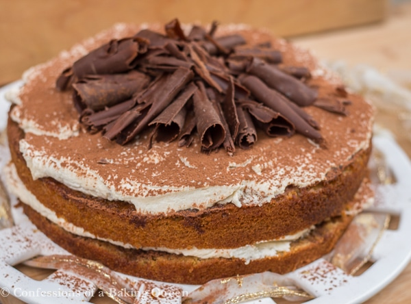 Tiramisu Cake on a white plate on a wood background