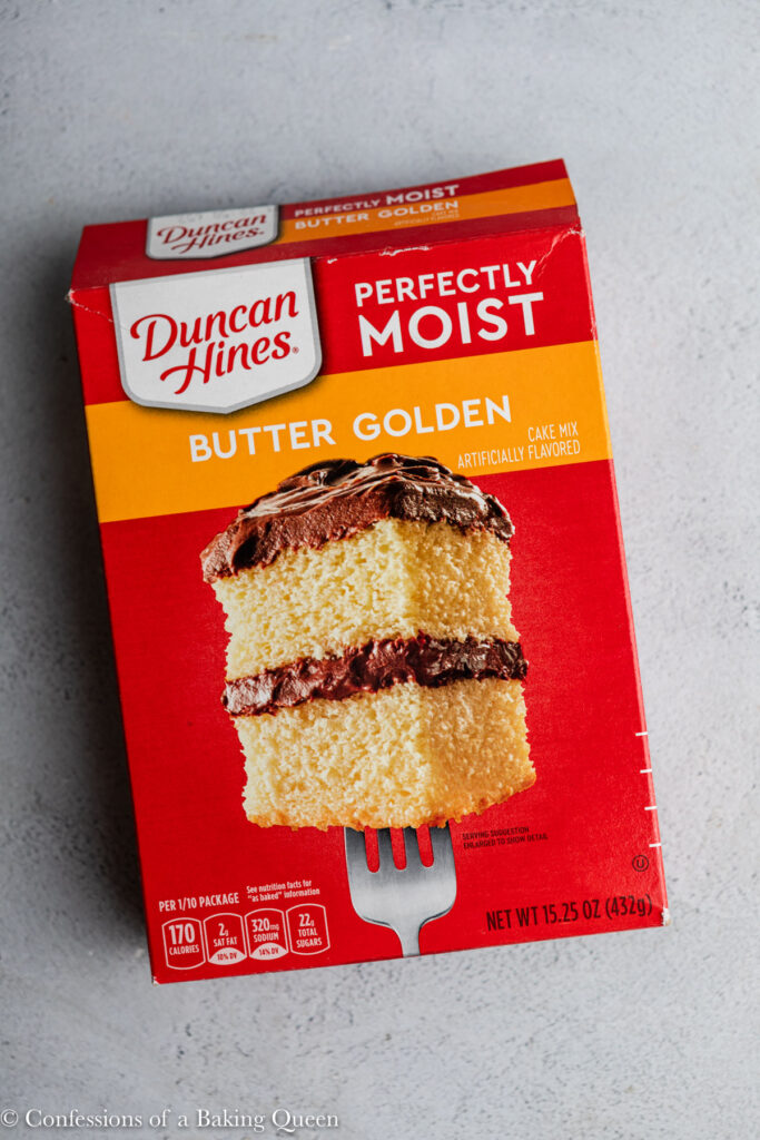 box of butter golden cake mix on a grey surface