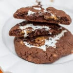Chocolate Toffee Cookies Stuffed with Marshmallow Creme & Cookie Butter broken on a white plate