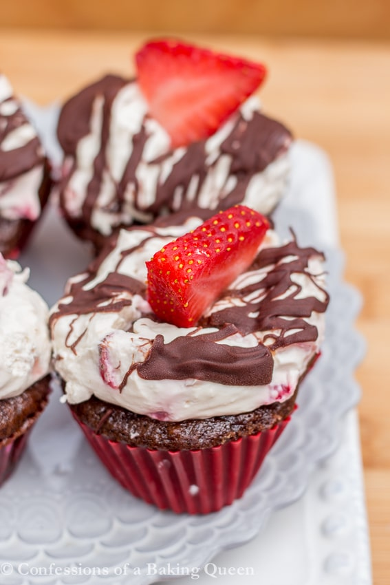 Strawberry Chocolate Cupcakes on a white plate on a wood background