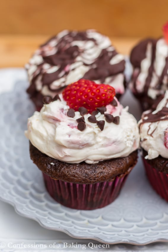 Strawberry Chocolate CupCakes on a purple plate on a white plate on a wood background