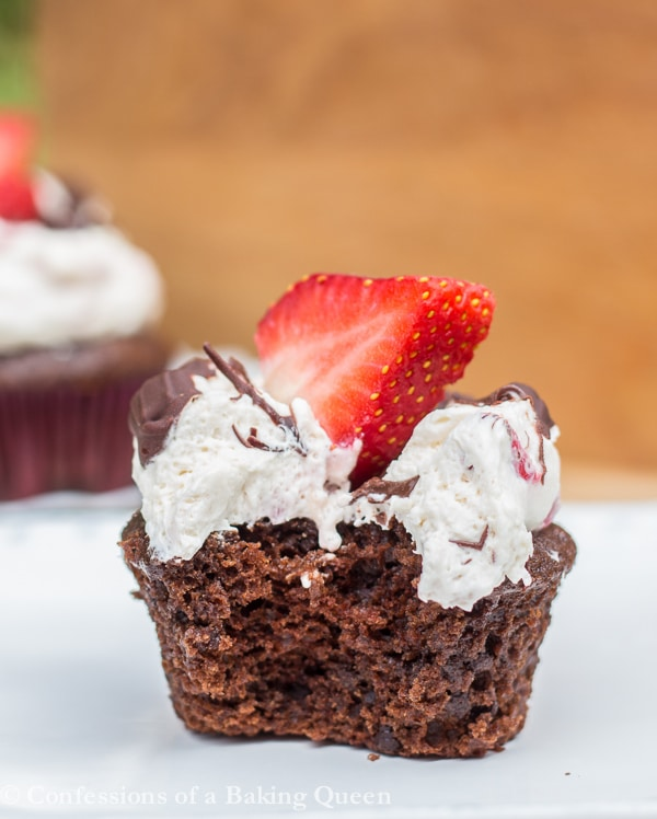 close up of Strawberry Chocolate Cupcake with a bite taken out on a white plate