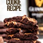 guinness chocolate cookies stacked with oozing chocolate on a white surface with a bottle of Guinness in the background