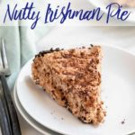 slice of nutty irishman pie on a white plate with black and silver forks